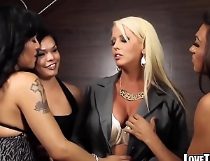 Busty MILF pornstar ganged banged by three hot shemales
