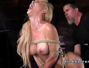 Hogtied blonde hanged in rope bondage