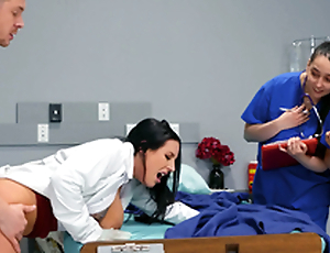 Doctor Angela White teaching her young med students on the job