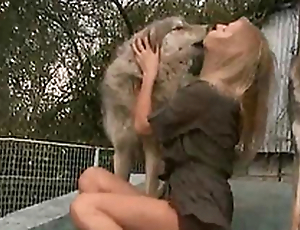 Oversexed and horny mistress kisses a dog on the porch of the house
