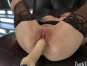 Busty machine mollycoddle in stockings toying pussy